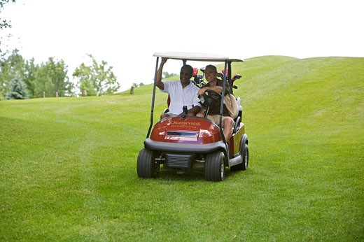 Stock Photo: 1828R-59941 Men in Golf Cart, Burlington, Ontario, Canada