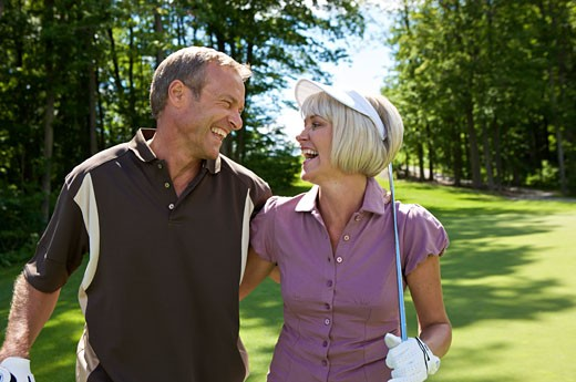 Stock Photo: 1828R-60019 Portrait of Couple Golfing