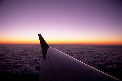 Stock Photo: 1828R-6004 Airplane Wing and Sunset
