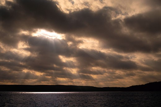 Stock Photo: 1828R-6069 Sunlight through Clouds over Cedar Lake, Algonquin Provincial Park, Ontario, Canada