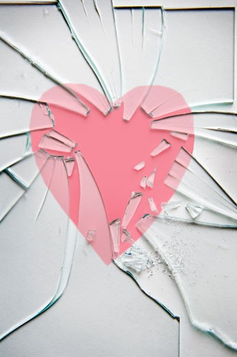 Stock Photo: 1828R-60693 Picture of a Heart in a Broken Picture Frame