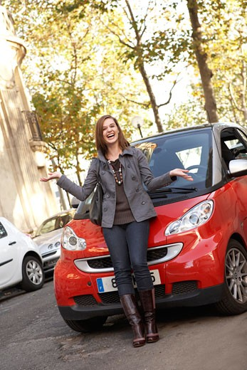 Woman Leaning on Front of Car, Paris, France    : Stock Photo