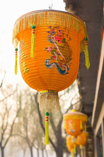 Stock Photo: 1828R-60903 Paper Lanterns Hanging Outside Restaurant, Beijing, China