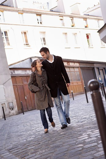 Stock Photo: 1828R-60946 Couple Walking on Cobblestone Street, Montmartre, Paris, France