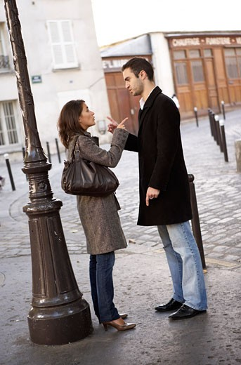 Stock Photo: 1828R-60950 Couple Arguing on Street, Montmartre, Paris, France