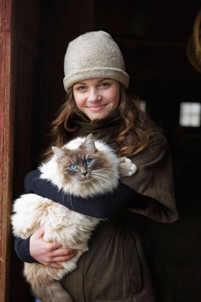 Portrait of a Teenage Girl Holding a Cat on a Farm in Hillsboro, Oregon, USA : Stock Photo