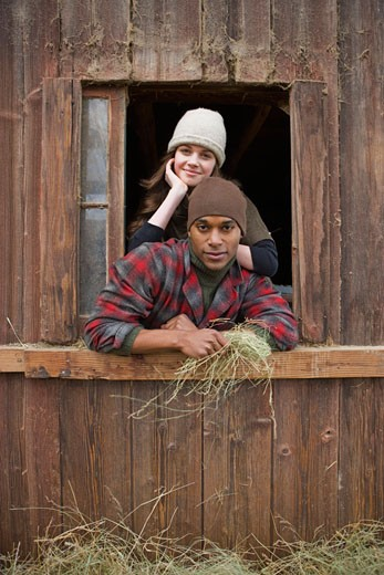 Stock Photo: 1828R-61210 Portrait of Couple Leaning Out Barn Window on a Farm in Hillsboro, Oregon, USA