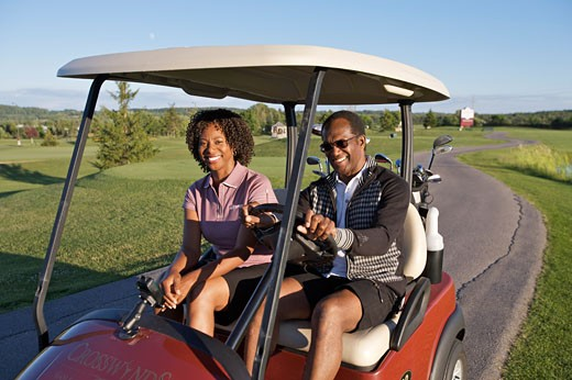 Stock Photo: 1828R-61449 Couple in Golf Cart, Burlington, Ontario, Canada
