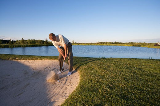 Stock Photo: 1828R-61451 Man Golfing, Burlington, Ontario, Canada