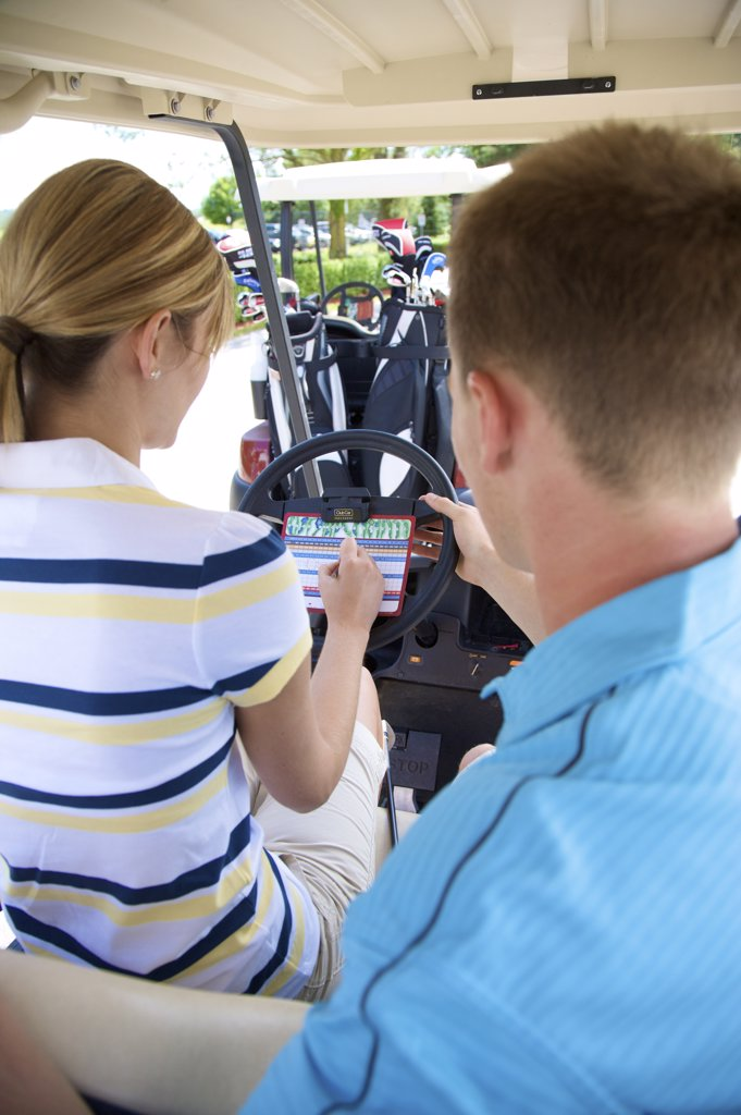 Stock Photo: 1828R-61516 Couple Sitting in Golf Cart, Burlington, Ontario, Canada