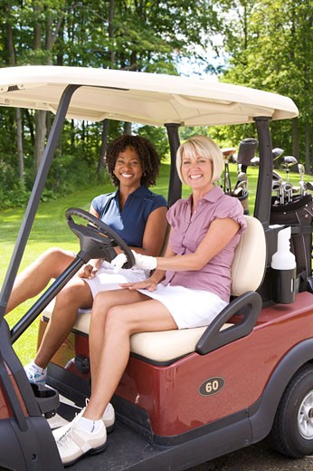 Women Sitting in Golf Cart, Burlington, Ontario, Canada    : Stock Photo