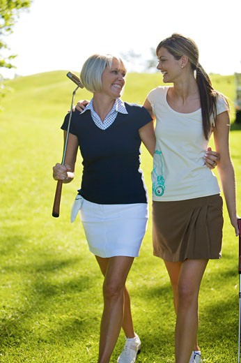 Stock Photo: 1828R-62082 Women Walking on Golf Course