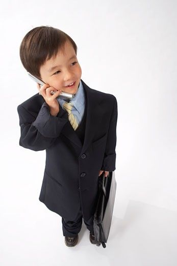 Little Boy Dressed Up as a Businessman Talking on Cell Phone : Stock Photo