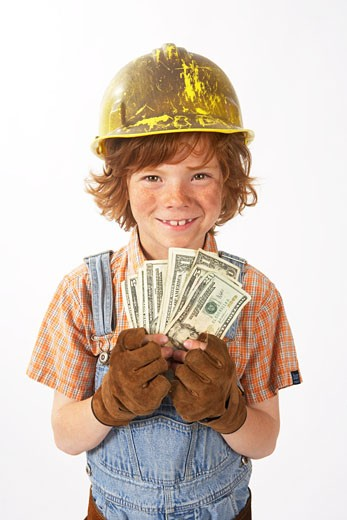 Stock Photo: 1828R-62362 Little Boy Dressed Up as Construction Worker Holding Cash