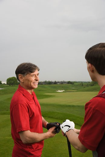 Stock Photo: 1828R-63709 Father and Son Golfing