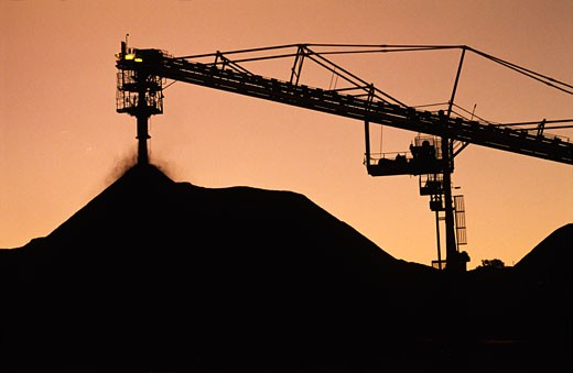 Stock Photo: 1828R-64181 Black Coal Mining, Stockpiling Coal, Sunset Silhouette