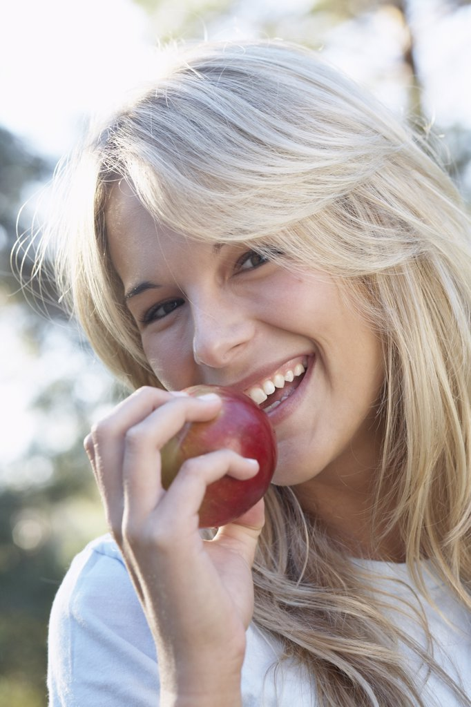 Woman Eating an Apple : Stock Photo