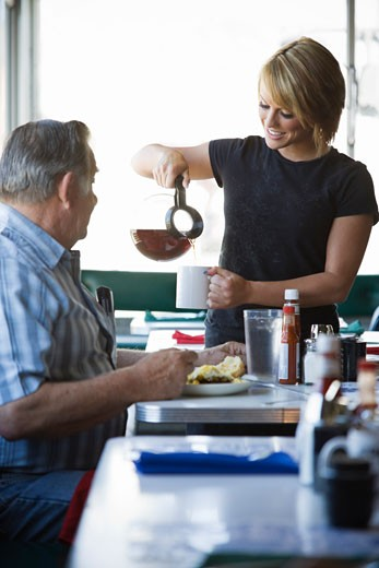 Stock Photo: 1828R-65317 Waitress Seving Coffee to Man