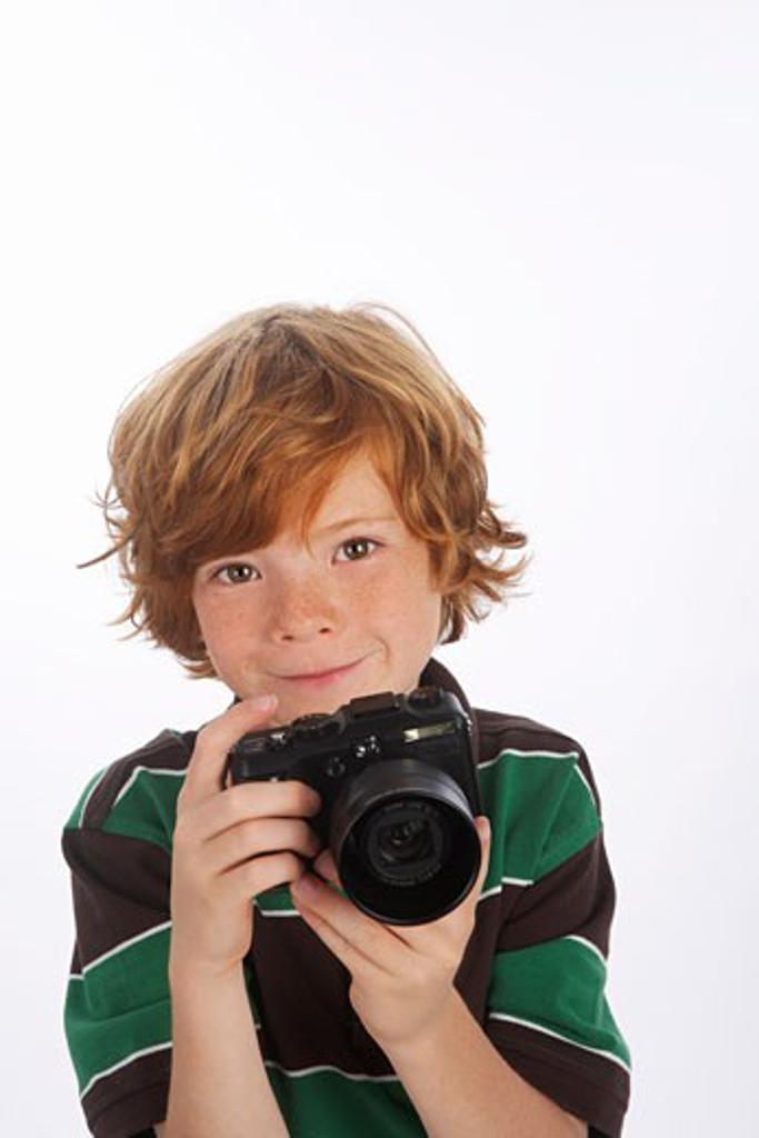 Boy Holding Camera : Stock Photo