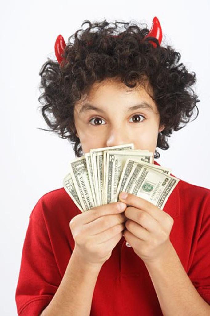 Little Boy Dressed as Devil Holding Cash : Stock Photo