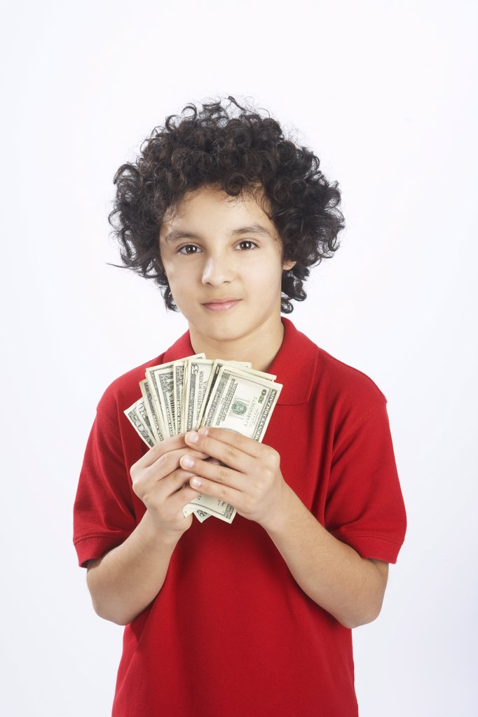 Stock Photo: 1828R-65376 Little Boy Holding Cash