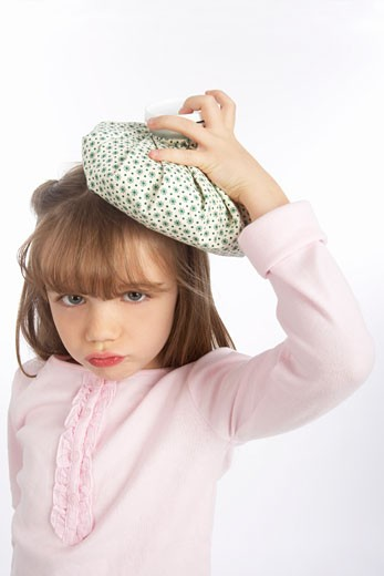 Stock Photo: 1828R-65409 Girl Holding an Ice Pack on Her Head