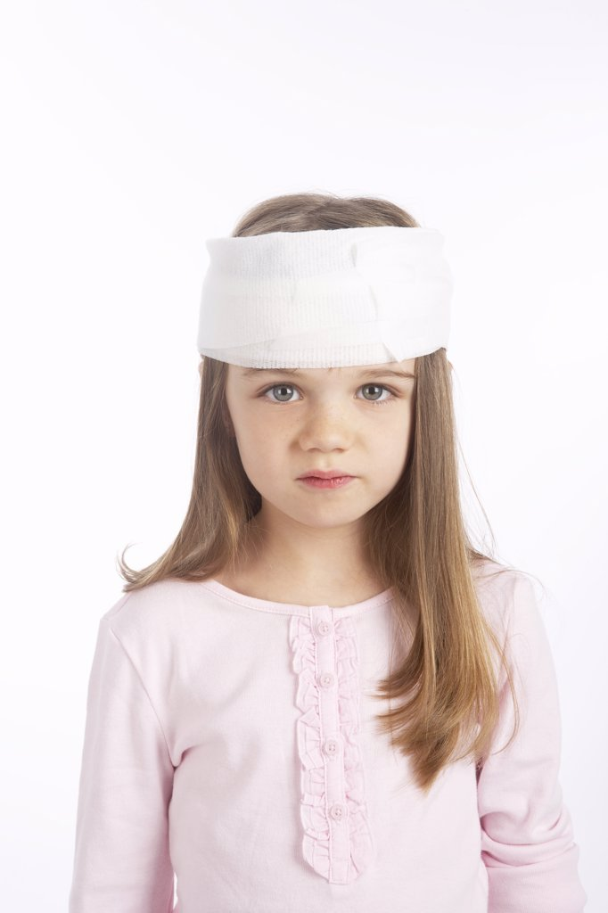 Stock Photo: 1828R-65411 Girl With a Bandage on Her Head