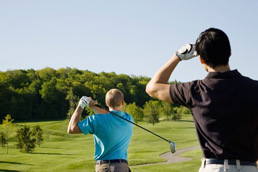 Stock Photo: 1828R-65625 Men Playing Golf