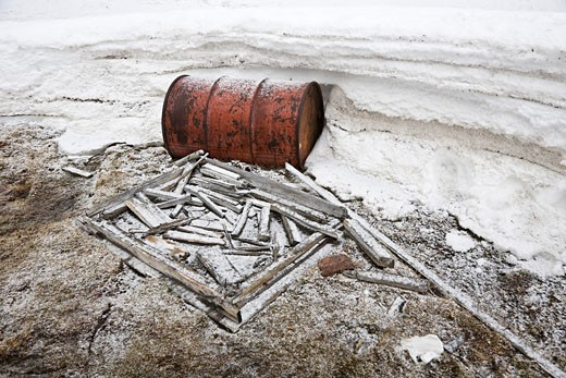 Stock Photo: 1828R-65763 Fuel Barrel and Scrap Wood by an Abandoned RCMP Post and Post Office