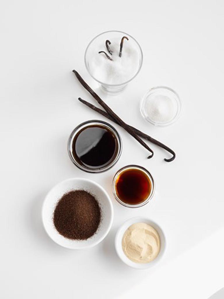 Stock Photo: 1828R-65904 Dried Vanilla, Vanilla Extract, Ground Vanilla and Vanilla Sugars