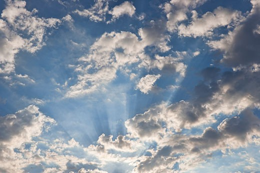 Sunrays From Behind Clouds : Stock Photo