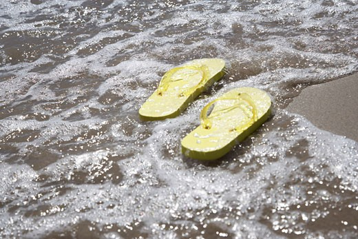 Flip Flops in Surf, Hulsig, Skagen, Nordjylland, Jutland Peninsula, Denmark : Stock Photo