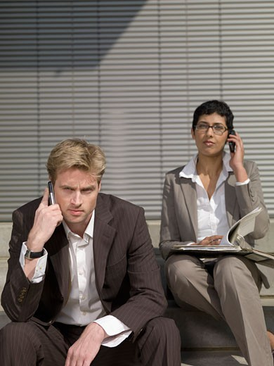 Businesspeople Outdoors on Cell Phones : Stock Photo
