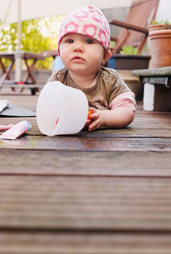 Stock Photo: 1828R-66847 Baby Lying on Deck