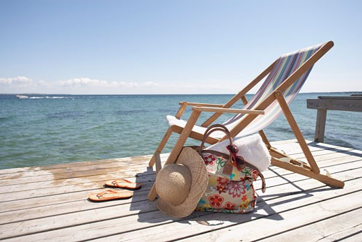 Stock Photo: 1828R-67572 Chair, Hat, Flip Flops and Bag on Dock