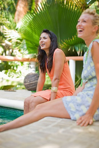 Two Women Relaxing Pool Side, Punta Burros, Nayarit, Mexico : Stock Photo
