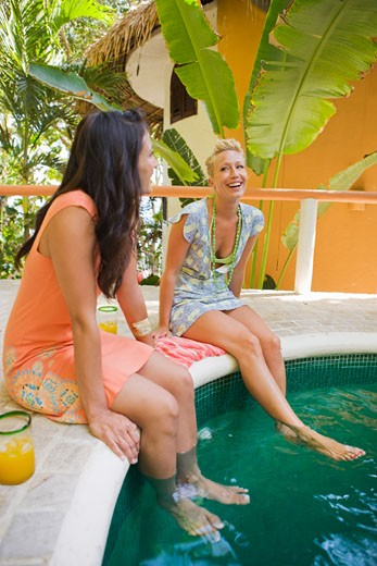 Stock Photo: 1828R-67862 Two Women Relaxing Pool Side, Punta Burros, Nayarit, Mexico