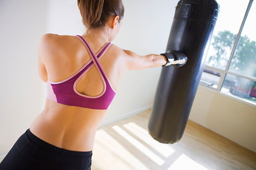 Woman Practicing Boxing : Stock Photo