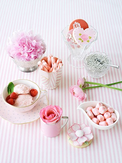 Tea Cups and Dishes Full of Sweets and Flowers : Stock Photo