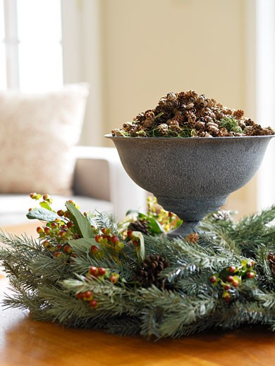 Stock Photo: 1828R-68074 Pinecones in Bowl with Wreath on Table