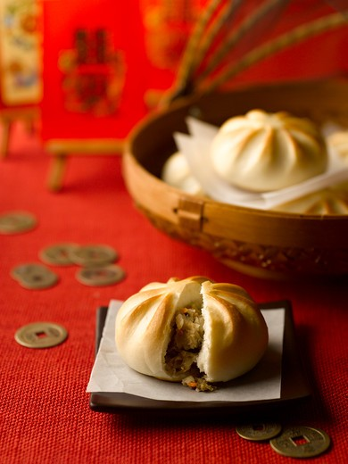 Chinese Buns and Coins : Stock Photo