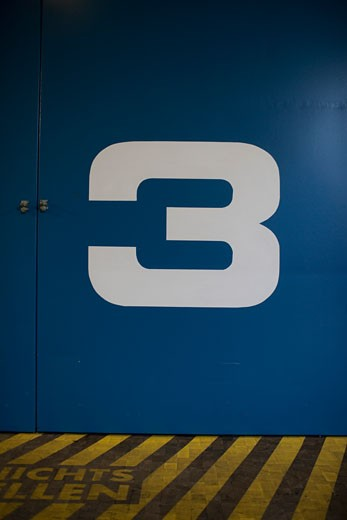Stock Photo: 1828R-69618 Close-up of the Number Three on a Door