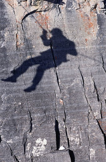 Stock Photo: 1828R-7007 Shadow of a Business Man on Side of a Mountain, Kananaskis Country, Alberta, Canada