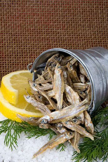 Dried Kapenta Fish With Lemon and Dill Garnish : Stock Photo
