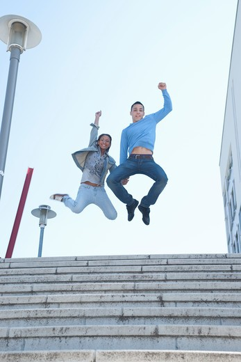 Stock Photo: 1828R-73848 Couple Jumping in Air
