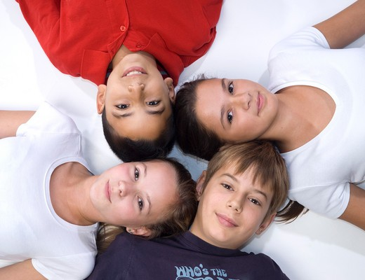 Stock Photo: 1828R-73951 Group of Children Lying in a Circle