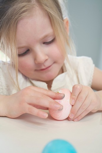 Stock Photo: 1828R-74574 Little Girl Decorating Easter Eggs