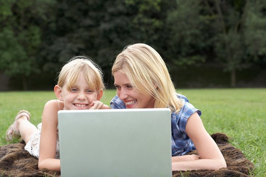 Stock Photo: 1828R-77053 Mother and Daughter using Laptop