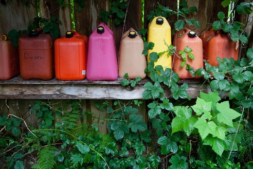 Stock Photo: 1828R-78173 Empty Gas Containers on Shelf