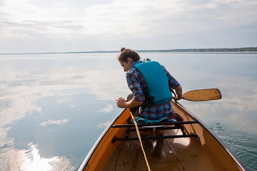 Woman Canoeing, Clearwater Lake, Clearwater Lake Provincial Park, Manitoba, Canada : Stock Photo